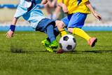 Boys kids children kicking soccer football ball. Young soccer football players