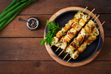Fototapety Chicken skewers with slices of apples and chili. Top view