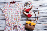 White blouse with colorful print. Bicolor handbag, blouse and footwear. Lady