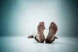 Dead person. Focus at the Feet