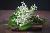 Bouquet of Lily of the valley flowers, selective focus, toned image