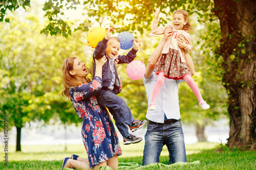 Young happy family having fun in the park