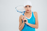 Portrait of a beautiful woman holding tennis racquet