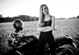 Beautiful woman on the motorcycle. black and white
