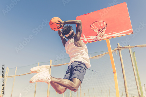 obraz PCV Basketball street player making a slam dunk outdoor