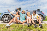 Group of friends taking a selfie at car trip around Europe