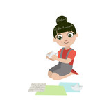 Girl Doing Paper Origami Boat