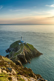 South Stack Lighthouse on a rocky island in North Wales on a sunny summer evening.