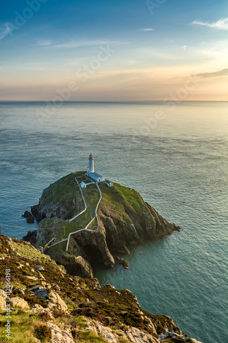 South Stack Lighthouse on a rocky island in North Wales on a sunny summer evening.  - 112066198