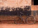 "bicicletta nera appoggiata al muro 112153322,fashion red hair woman wearing pink piece garment"""
