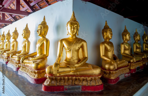 Foto op Plexiglas Indonesië Gold buddha statue in thai temple, They are public temple in Tha