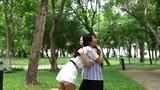 Young female friends having fun when meet in garden