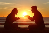 Couple dating falling in love at sunset