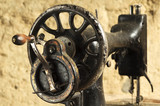 vintage  manual sewing machine made of metal with painted design
