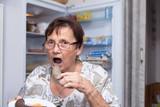 Senior woman eating pork liver sausage