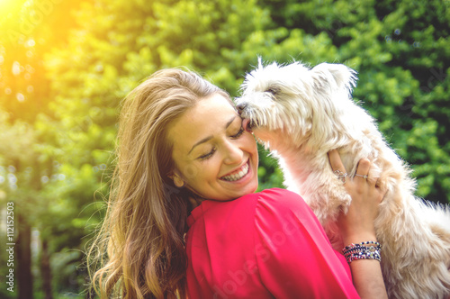 Attractive caucasian girl having fun with her dog