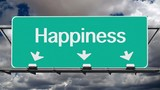 Road to happiness freeway sign with time lapse clouds.