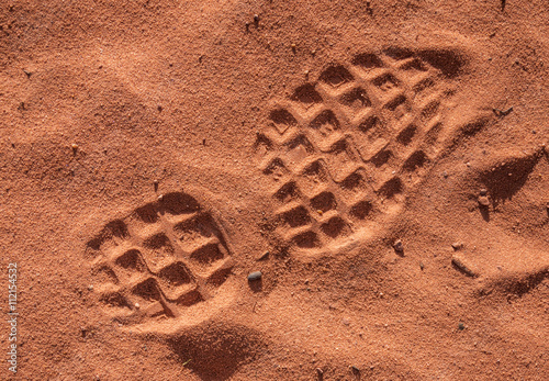 Poster shoe footprint on sand