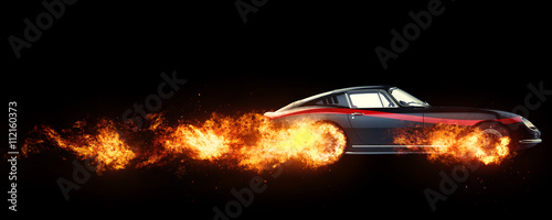 Fototapeta Black vintage race car with red stripe decal - wheels on fire - isolated on black background