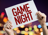 Game Night placard with night lights on background
