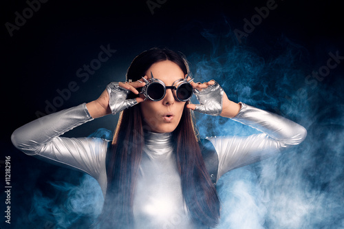 Surprised Woman in Silver Costume and Steampunk Glasses Poster