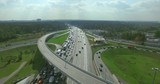 Aerial view of highway interchange near modern city or in the countryside on a cloudy summer day. Heavy traffic on a rush hour in Moscow, Russia.