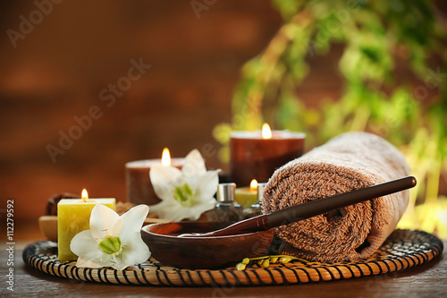 Spa chocolate set with candles on blurred background © Africa Studio