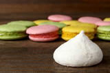macaroon with cookies on wooden brown background
