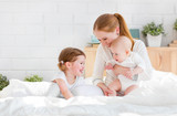happy family mother and two children, son and daughter in bed