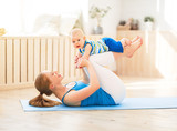 sports mother is engaged in fitness and yoga with baby at home