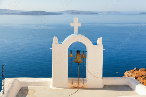 Plagát, Obraz Church bell in Oia, Santorini, Greece