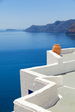 A perfect view of the volcano in Oia, Santorini with blue waters of the sea