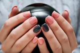 gray pink manicure with ball in hand