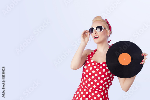 Pin-up girl in vintage dress holding a vinyl record  Poster
