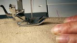 Close up Video of Sewing Machine  - Sew A Dress In A Textile Factory. Slow Motion Full Hd Stock Footage Clip.