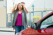 Couple Standing In Front Of New Car