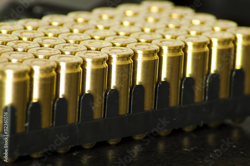 Poster 9mm bullet for a gun isolated on dark background.