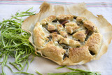 savory tart stuffed with vegetables on baking parchment