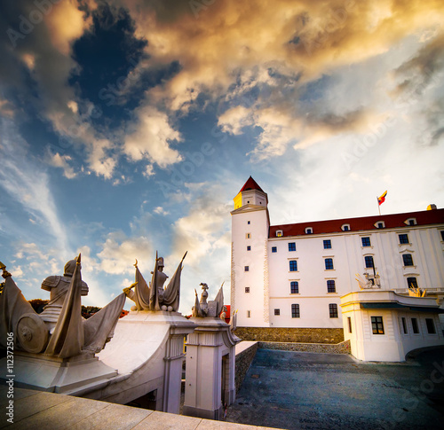 Poster Traditional sculptural group of Bratislava castle at sunset