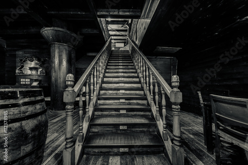 Keuken foto achterwand Schip Wooden staircase. Interior of old pirate ship. Black and white
