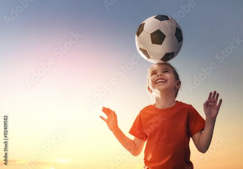 Girl plays football.
