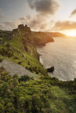 Beautiful evening sunset landscape image of Valley of The Rocks