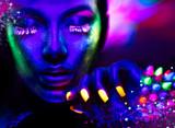 Fototapety Fashion woman in neon light, portrait of beauty model with fluorescent makeup