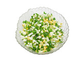 Salad of green onions with eggs on a light background