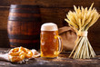 mug of beer with wheat ears and pretzel
