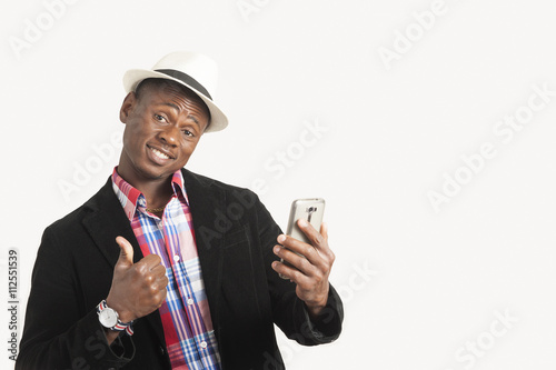 Young african american man using a mobile phone Poster