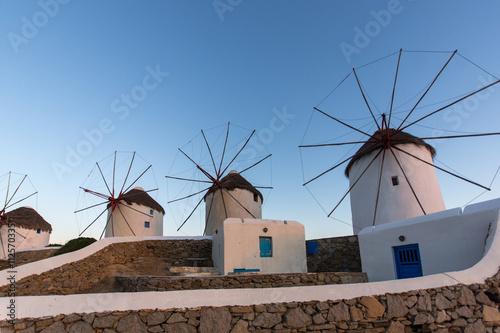 Zdjęcia na płótnie, fototapety, obrazy : Twilight view of White windmills on the island of Mykonos, Cyclades, Greece