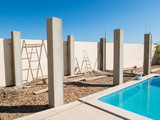 The pillars of a pool side pergola during construction.