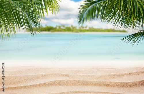 Sandy tropical beach with island on background Poster