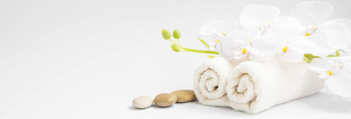 Spa orchid with soft towels and massage stones setting © marrakeshh